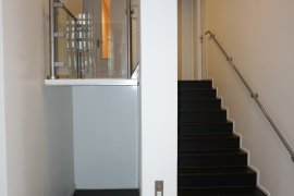 Stairs in the David de Wied building with wheelchair lift