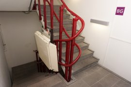 A staircase with staircase elevator (NOT FUNCTIONING) at the Willem C. Schimmel building
