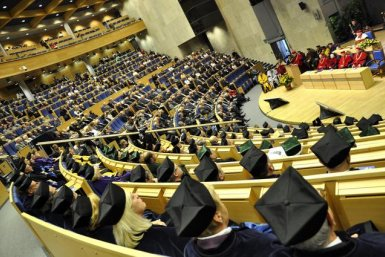 A graduation ceremony in a very large lecture room at the University of Krakow.